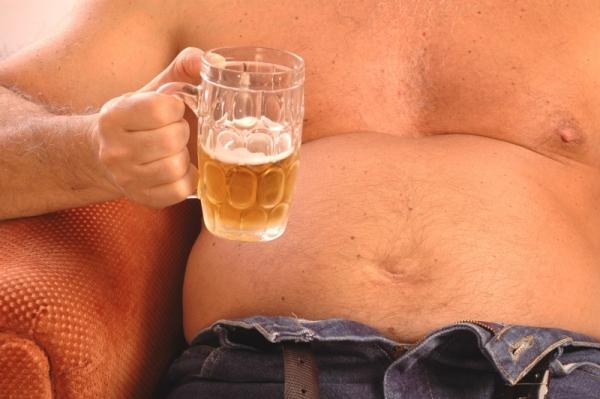 почему появляется жир внизу живота